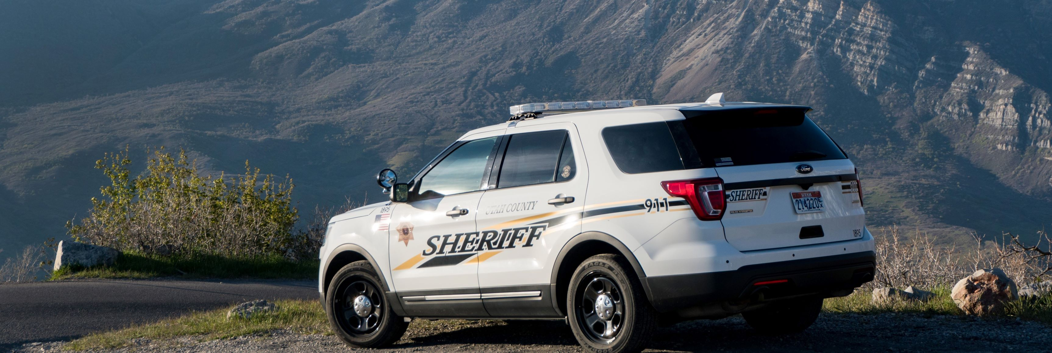 Provo Canyon with Sheriff's Office Car